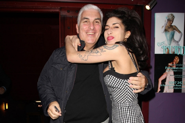 Amy and Mitch Winehouse after his performance at Cityburlesque, London, October 7, 2010 / Photo by Fred Duval/FilmMagic