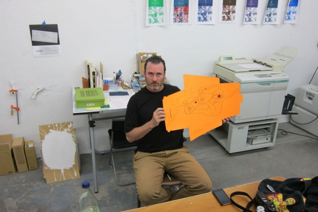 Artist Ed Templeton shows off his contribution to an LP cover sleeve. / Photo by Randy Randall