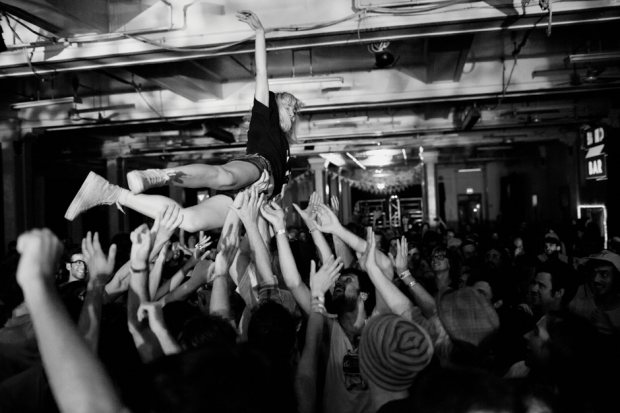 Caila Thompsis-Hannant of Mozart's Sister crowd-surfing / Photo by Richmond Lam