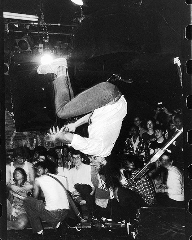 Bad Brains' H.R. does a backflip at CBGB's, c. 1982 / Photo by Glen E. Friedman