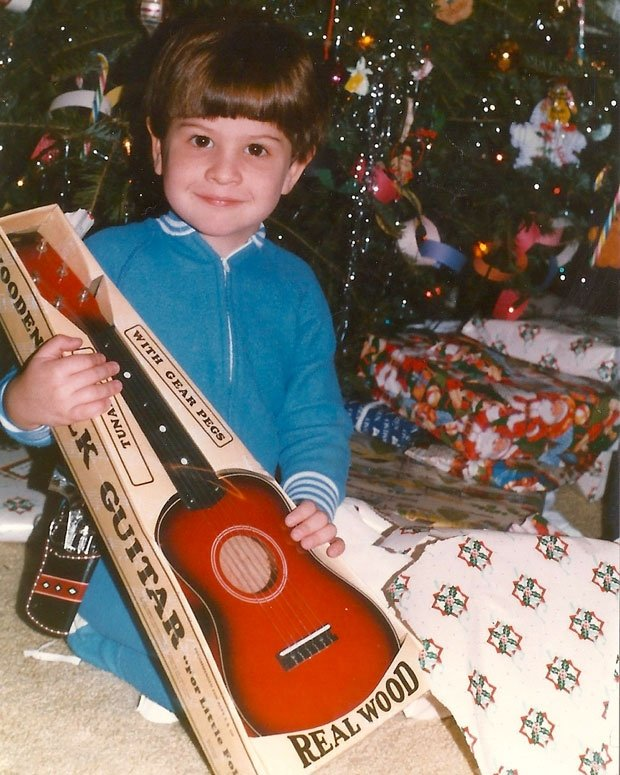 A young Kyle Thomas gets his first guitar for Christmas / Photo courtesy King Tuff