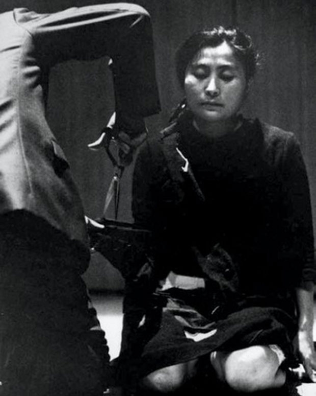 """Cut Piece"" performed by Yoko Ono on July 20, 1964 in Kyoto, Japan / Photo courtesy Lenono Photo Archive"