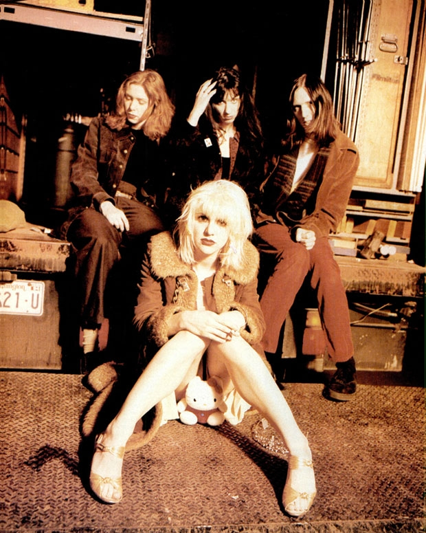 Patty Schemel, Courtney Love, Kristen Pfaff, and Eric Erlandson. / Photo by Jeffrey Thurnher